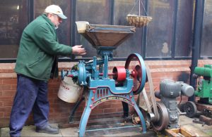 Barn engine provides the power to grind corn